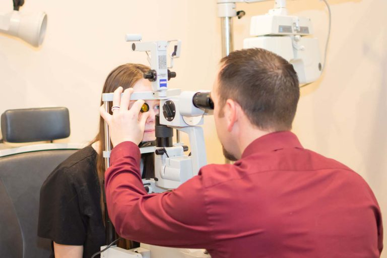 Doctor Seamons checking eye of patient